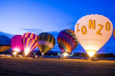 Hot air balloons lit up in the Yarra Valley