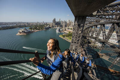Young woman climbing the Sydney Harbour Bridge